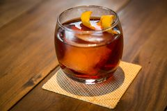 Negroni Drink ZK. The Negroni cocktail is made of one part gin, one part vermouth rosso red, semi-sweet, and one part Campari, garnished with orange peel. It is Royalty Free Stock Image