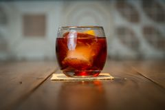 Negroni Drink ZK. The Negroni cocktail is made of one part gin, one part vermouth rosso red, semi-sweet, and one part Campari, garnished with orange peel. It is Stock Photography