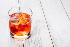 Negroni on a wooden board, white background Royalty Free Stock Images