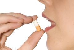 Nehmen der Pille Lizenzfreie Stockfotos
