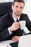 Nehmen einer Kaffeepause Lizenzfreies Stockbild