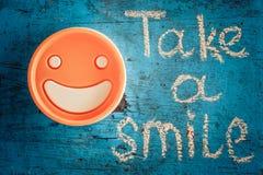 Nehmen Sie ein Lächeln Motivaufschrift Lizenzfreie Stockbilder