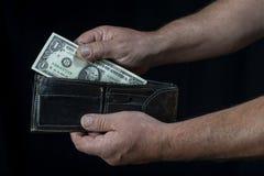 Nehmen von einem Dollar Stockbild