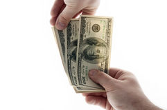Nehmen von einer Handvoll Geld Stockfotos