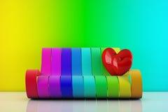 Nei cuori di amore che si levano in piedi su uno strato del Rainbow Fotografia Stock