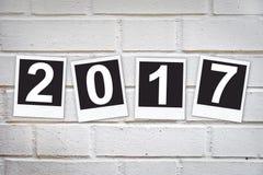 2017 nei telai istantanei della foto su un muro di mattoni Fotografia Stock Libera da Diritti