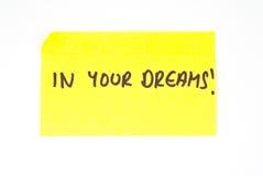 'Nei vostri sogni!' scritto su una nota appiccicosa Immagine Stock