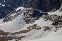 Neige accumulée sous l'ange de glacier Photo libre de droits