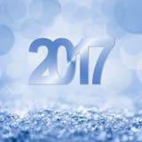 neige de 2017 bleus et carte de voeux de bokeh Photos libres de droits