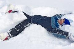 neige de garçon Photo stock