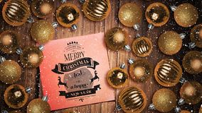 Neige en baisse et décorations de note et de babiole de textes de Joyeux Noël sur le bois clips vidéos