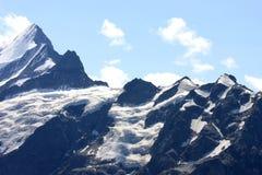 Neige et glace hautes dans les montagnes suisses Photographie stock