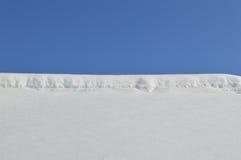 Neige sur le fond du ciel Photo stock