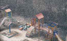 neige sur le terrain de jeu Photographie stock libre de droits