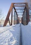 Neige sur le tressle de chemin de fer Photos stock