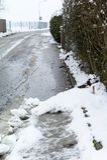 Neige sur le trottoir Photographie stock libre de droits