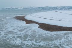 Neige tombant sur la côte jurassique photos libres de droits