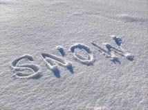 Neige Word dans la neige Photo stock