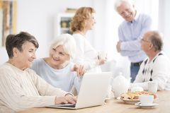 Neighbor helping older woman Stock Photo