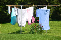 Neighbor's Laundry. Colorful laundry hanging out on a clothes line Stock Photography