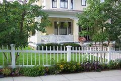 The neighborhood. Photo of fine home in Washington D.C. with summertime garden and flowers Stock Photo