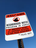 Neighborhood Crime Watch Police Warning Sign. Residential suburb American neighborhood crime watch local police warning street sign over blue sky Stock Photography