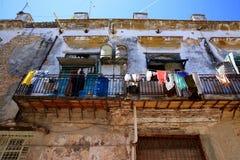 Neighborhood in Disrepair, Havana, Cuba. An old, decaying neighborhood in downtown Havana, Cuba Royalty Free Stock Photo