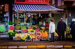Neighborhood Greengrocer With Customers Royalty Free Stock Images