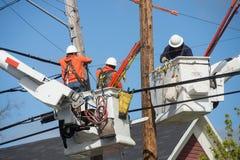 Neighborhood powerline workers Stock Photo