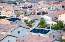 Neighborhood Roof Tops with Solar Panels Stock Photography