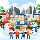 Neighborhood scene with four boys in winter clothes Royalty Free Stock Image
