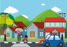 Neighborhood scene with man and boy crossing road Stock Photo