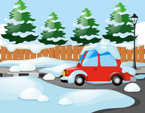 Neighborhood scene with red car covered with snow Stock Image
