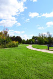 Neighborhood Sidewalk Winding Through a Park on a Beautiful, Fall Day Royalty Free Stock Photos