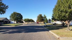 Neighborhood Street with Parked Cars Royalty Free Stock Photo