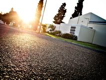 Neighborhood street at sunrise. Landscape photo of a Neighborhood street at sunrise royalty free stock images