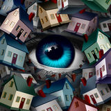 Neighborhood Watch. And home security concept as a group of houses covering a human eye ball as a real estate or inspection metaphor as a 3D illustration Royalty Free Stock Photos