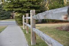 Neighborhood fence in early spring Royalty Free Stock Photos