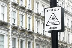 Neighbourhood watch area sign post in London Kensington city royalty free stock photography