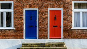 Neighbouring Terraced Houses With One Blue And One Red Front Doo Stock Images