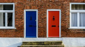 Neighbouring Terraced Houses With One Blue And One Red Front Doo Stock Photos