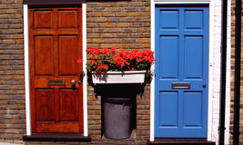 Neighbours. Two sets of doors in Kensington, London Stock Photography