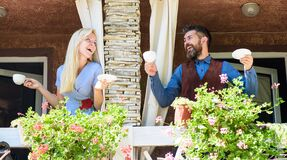 Free Neighbours Drinks Coffee At Balcony And Speaking. Stock Images - 175457334