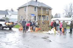 Neighbours and residents working to fill sand bags. Friends, neighbors and strangers come together during the May 2017 floods to fill sand bags - to protect Stock Image