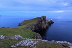 Neist Point. Cliffs, blue sea and white lighthouse. Neist Point in summer, isle of skye, Scotland stock images