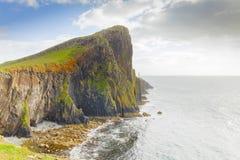 Neist point cliffs and lighthouse scotland skye island. Neist point cliffs and lighthouse in skye island scotland Royalty Free Stock Photos