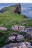 Neist Point Lighthouse, amazing tourist attraction, Scotland, UK royalty free stock photography