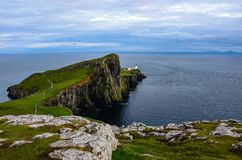 Neist Point Lighthouse, Isle of Skye, Scotland. Neist Point Lighthouse in cloudy weather. Cliff dotted with sheep. West-most point of Isle of Skye, Scotland Stock Photos