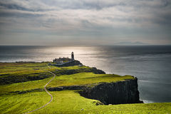 Neist Point lighthouse at Isle of Skye in Scotland Stock Photo