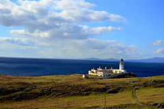 Neist Point lighthouse. Lighthouse on Neist Point peninsula, Isle of Skye, Scotland Royalty Free Stock Images